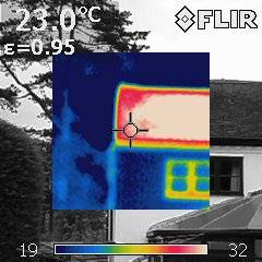 Thermal image of a roof with the red showing the heat loss